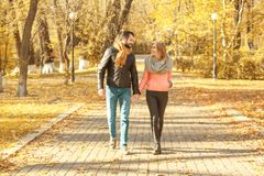Young couple walking in park. On autumn day Royalty Free Stock Photo