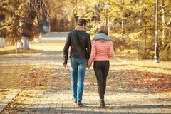 Young couple walking in park. On autumn day Stock Photo
