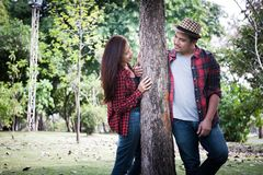 Young couple walking in the park, Romantic feelings. stock photography