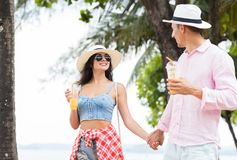 Young Couple Walking In Park On Seaside Holding Hands Happy Man And Woman Tourists Talking On Vacation Royalty Free Stock Image