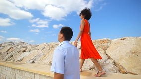 Young couple walking on the pier. Young man and beautiful woman on quay stock footage