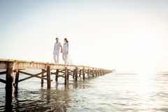 Young Couple Walking On Pier stock images