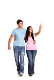 Young couple walking and pointing Royalty Free Stock Photos