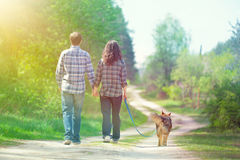 Young couple walking on rural road Stock Photos