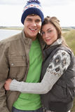 Young Couple Walking Through Sand Dunes. Wearing Warm Clothing Stock Image