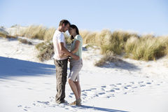 A young couple walking in sand dunes stock images