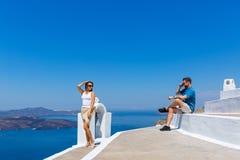 Young couple walking on Santorini stock photo