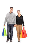 Young couple walking with shopping bags Stock Photography