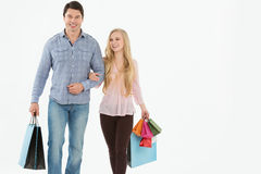 Young couple walking with shopping bags Stock Image