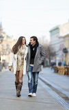 Young couple walking on street Stock Photography