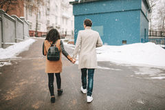 Young couple walking the street hand in hand in winter Stock Photo