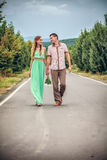 Young couple walking in street Stock Photos