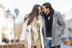 Young couple walking on the street Stock Images