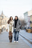 Young couple walking on the street Royalty Free Stock Image
