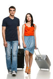 Young couple walking with suitcases Royalty Free Stock Photo