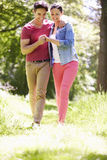 Young Couple Walking In Summer Countryside Stock Photo