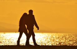 Young Couple Walking Sunset Stock Photography