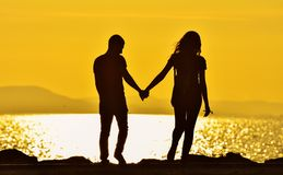 Young Couple Walking Sunset Royalty Free Stock Images