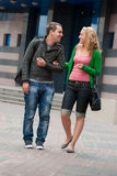 Young couple walking and talking. In a street Stock Image