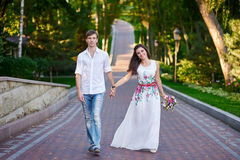 Young couple walking together hand by hand Royalty Free Stock Image