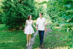 Young couple walking together holding hands royalty free stock images