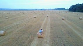 Couple walking near haystack stock footage