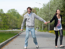 Young couple walking together in park Royalty Free Stock Photography