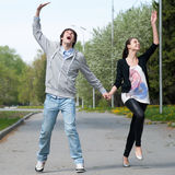 Young couple walking together in park Stock Photo