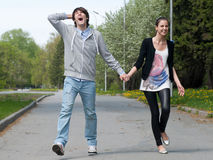 Young couple walking together in park Royalty Free Stock Images