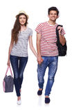 Young couple walking with travel bags Stock Photos