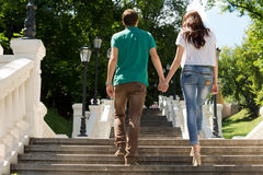 Young couple walking up a flight of steps Stock Photography