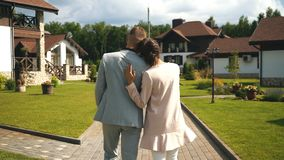 Young couple walking,the woman rested her head on the shoulder of men stock video