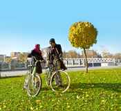 Young couple walks  with a bicycle Stock Photos