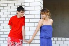 A young couple walks in the Design and constructio Stock Photos