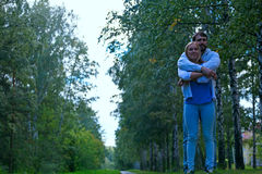 Young couple walks in forest Royalty Free Stock Photo