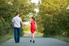 Young couple walks in park Royalty Free Stock Image