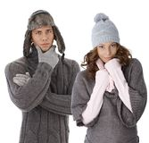 Young couple in warm clothes. Young couple dressed for winter, wearing gloves and hat and warm sweater Royalty Free Stock Image
