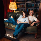 Young couple watch tv at home. Leisure, fun, rest. Royalty Free Stock Photography