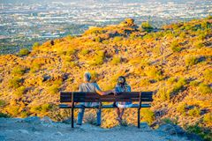 Young Couple Watches Sunset royalty free stock photo
