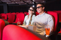 Young couple watching a 3d film Royalty Free Stock Photos