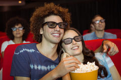 Young couple watching a 3d film Royalty Free Stock Photography