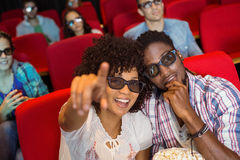 Young couple watching a 3d film Stock Image