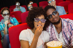 Young couple watching a 3d film Royalty Free Stock Images
