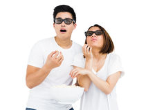 Young couple watching a 3d movie Royalty Free Stock Photography