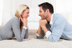 Young couple watching each other. Gazing into each others eyes with love Stock Photo