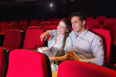 Young couple watching a film Royalty Free Stock Image