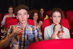Young couple watching a film Royalty Free Stock Images