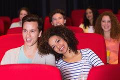 Young couple watching a film Royalty Free Stock Photos