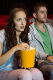 Young couple watching a film Stock Images