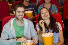 Young couple watching a film Royalty Free Stock Photo